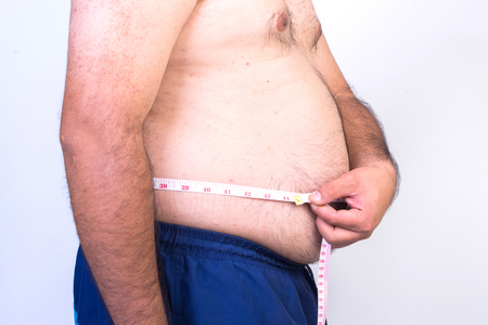 potbellied: Fat man trying to measure waist circumference