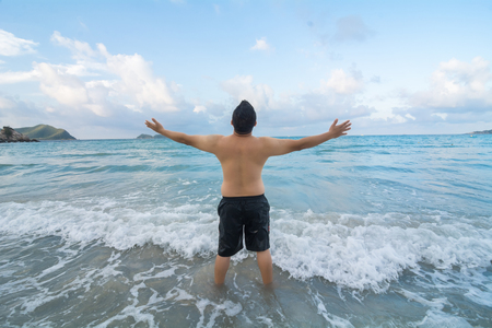 greatness: Mature man with open arms at the beach praising the greatness of a higher power Stock Photo