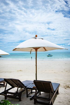 Sun loungers on the beach At Koh Samet Thailand.Happy Holidays Concept