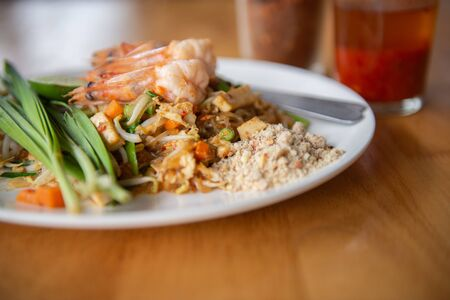 fried noodle or Pad Thai and shrimp, popular menu of Thailand. Stock Photo