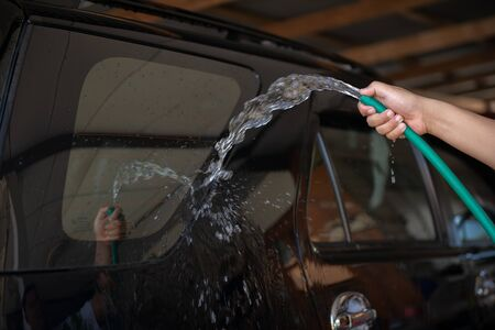 Manual car wash with water tube