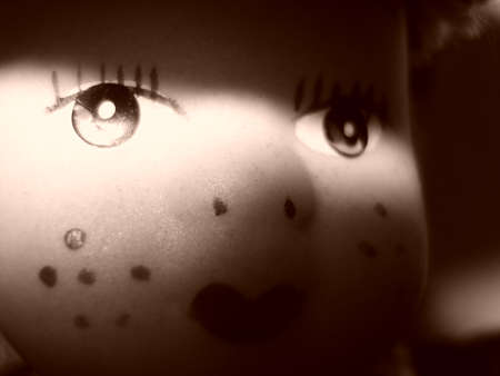 onlooker: Reflection on the face of a doll
