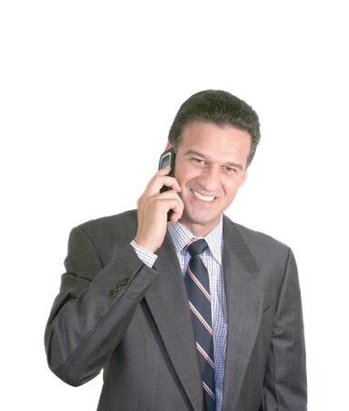 Matured Businessman talking on a cellphone photo