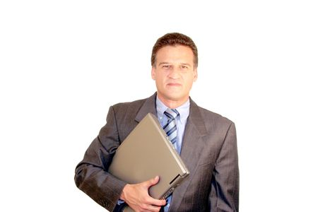 Businessman carrying a laptop Stock Photo - 3068419