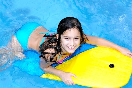 floater: Young girl in a swimming pool Stock Photo