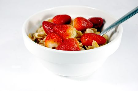 cereal bowl with strawberries isolated on a white background