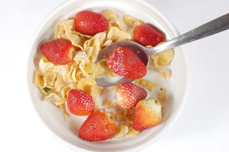 cereal bowl with strawberries from a top angle