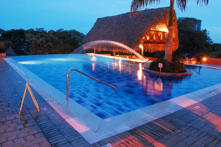 Night shot of swimming pool at a beach resort