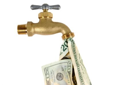 Water tap dripping dollar bills, Water waste concept Stock Photo
