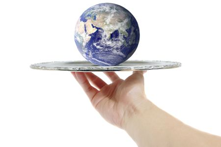 Hand holding a silver tray with the world on it