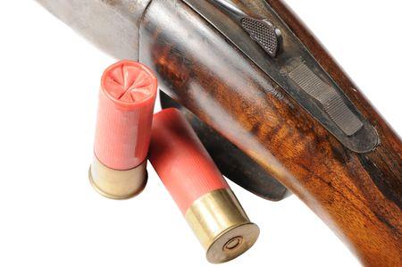 Macro shot of a shtgun and shells on white photo