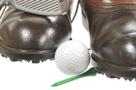 Macro shot of  golf shoes, iron  and ball on white