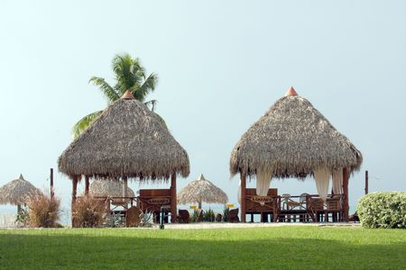 Two beach huts in a tropical resort Stock Photo