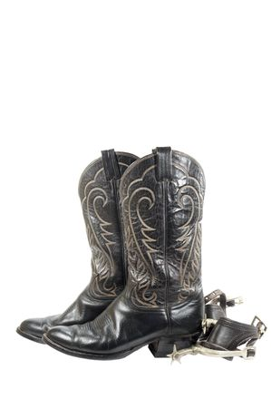 spurs: Old black western boots and spurs isolated on white Stock Photo