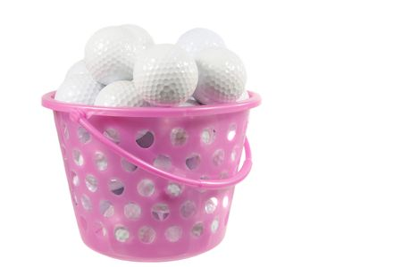 Bucket with golf balls isolated on white Stock Photo