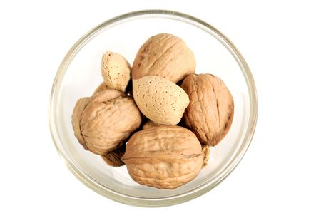 Macro shot of a small bowl with nuts on white Stock Photo - 6755533