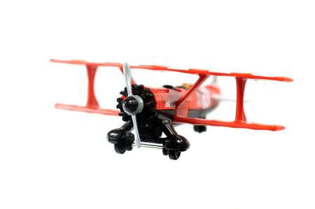 Toy red bi-plane  isolated on a white background Stock Photo - 6755518