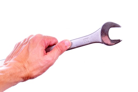 Hand holding a combination wrench isolated on white Stock Photo - 16442210
