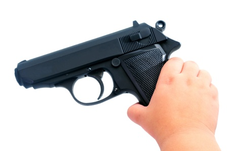 grabing: Child s hand holding a gun isolated on white