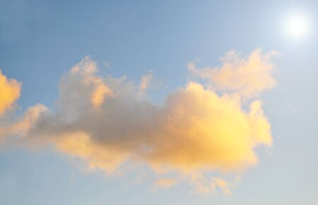 Afternoon clouds with the sun shining through Stock Photo - 17001521