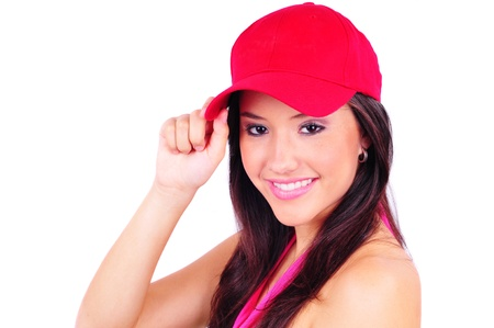 red head girl: Attractive young woman wearing a red baseball cap