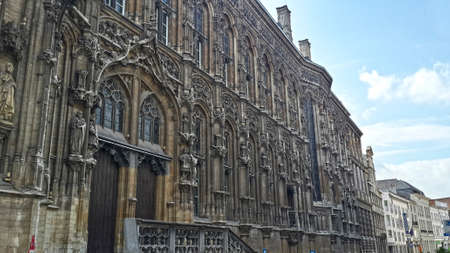 faade: City of Ghent town hall building with a flamboyant Gothic style of the fa?ade Stock Photo