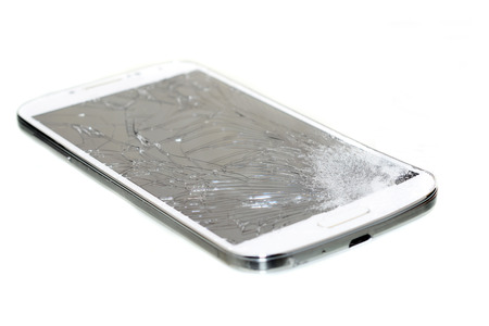 cell damage: Cell phone with a broken screen  isolated on white