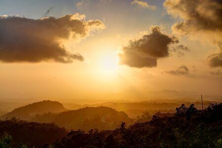 orange sunset: Beautiful yellow and orange sunset in the mountains of Panama Stock Photo