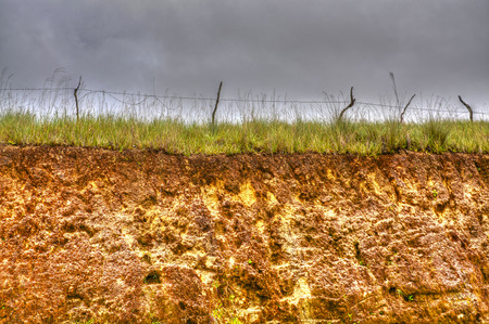 Old Barbwire fence on top of a hill on HDR photo