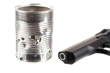 full of holes: Target practice Tin can full of holes with a gun isolated on white Stock Photo