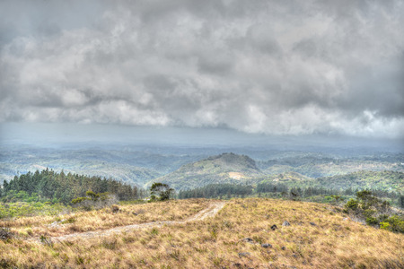 storm coming: Storm coming in close to a mountain range in Panama Stock Photo