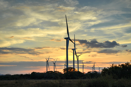 lowlands: Wind turbines   against a beautiful sunset  in the central lowlands of Panama