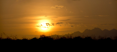 lowlands: Beautiful sunset at the lowlands of Panama showing the central mountains in the background