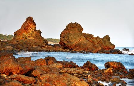 bathed: Big boulders being bathed by ocean water