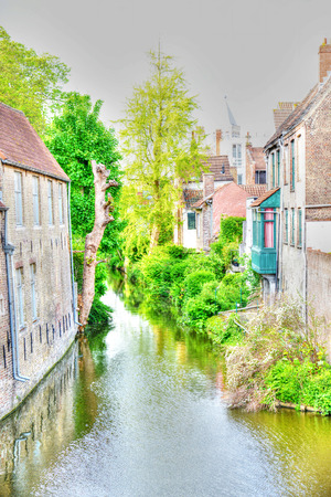 View of a canal with old houses in Bruges, belgium