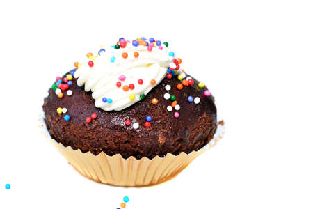 Close up of a chocolate cupcake with decoration sprinkles Stock Photo