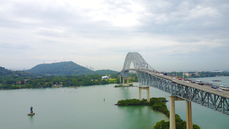 Aerial view of The Bridge of the Americas,  a road bridge in Panama, which spans the Pacific entrance to the Panama Canal. Stock Photo