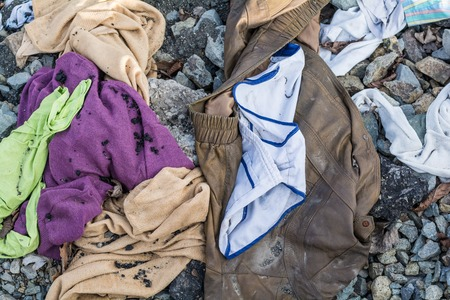 tramp: Old clothes of Tramp scattered stone pavement