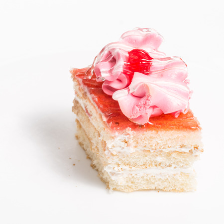 Small piece of cake - petit fours on a white background photo