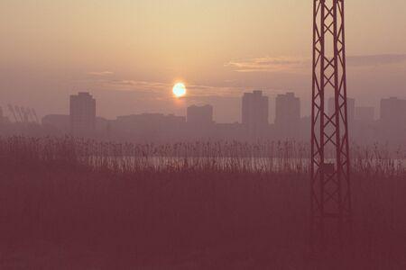 vilnius: Building silhouettes in purple cloudy sunset background, dark photo, dramatic sunset, city scene on sunset, Vilnius, Lithuania