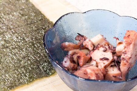 Cooking sushi at home with nori, octopus. photo