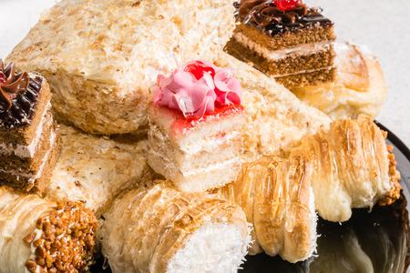 creampuff: Eclair tasty dessert with cream and powdered sugar