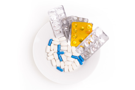 illnesses: White and blue medical pills for treating illnesses on a white background