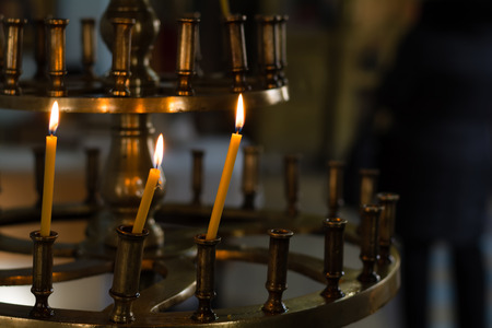 candlelight memorial: Religious church candle in temple for prayer