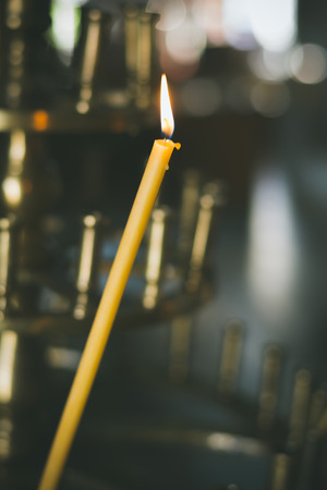 memorial day: Religious church candle in temple for prayer