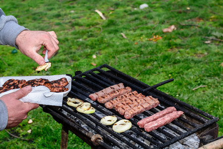 bbq picnic: Delicious grill outdoors. Baking meatballs on charcoal.