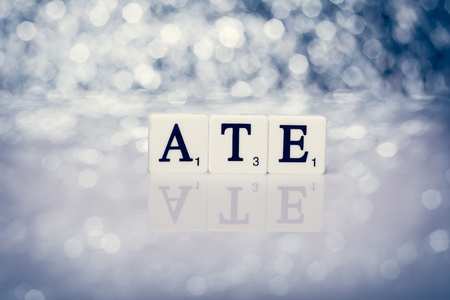 ate: Created word of tiles with letters - ate Stock Photo