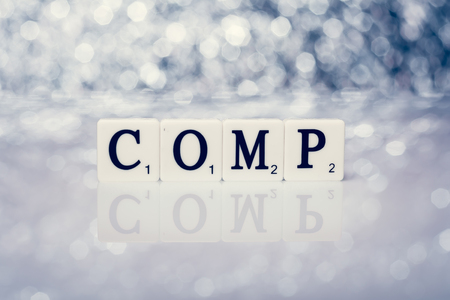 comp: Created word of tiles with letters - comp Stock Photo