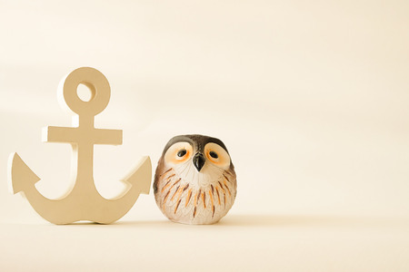 wooden anchor in vintage with owl decorative background Stock Photo