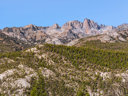 Classic panoramic view of The Minarets in the Ritter Range as seen from the popular Minaret Vista lookout point in Mammoth Lakes area. High jagged peaks of the Sierra Nevada mountains in early autumn.